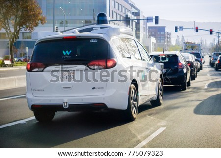December 9, 2017 Mountain View / CA / USA - Waymo self driving car stopped at a traffic light, Silicon Valley, San Francisco bay