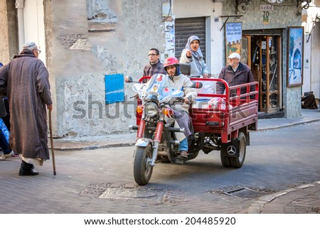 DECEMBER 15,2012-TANGIER, MOROCCO: In the photo we see a motorcycle tranpostando people are very common in Morocco that these vehicles make public transport - stock photo