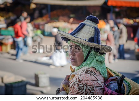 DECEMBER 15,2012-TANGIER, MOROCCO: In the photo we see a peasant coming down the field Sunday to sell their products in the old medina of Tangier she wears the typical Moroccan costume - stock photo