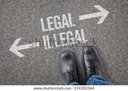 Decision at a crossroad - Legal or Illegal - stock photo
