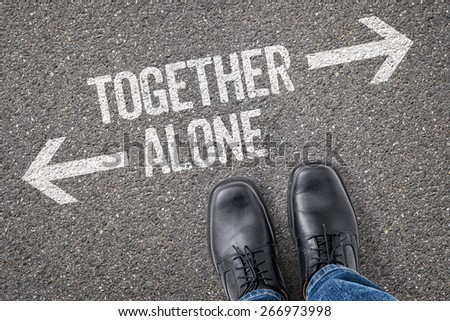 Decision at a crossroad - Together or Alone - stock photo