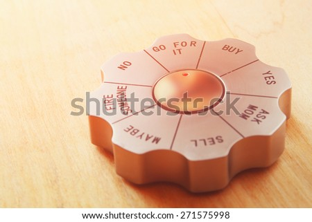 decision maker office gadget set to the words go for it. business and and decision making concept. image is retro filtered - stock photo