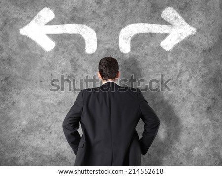 Decision making concept - businessman making decisions - stock photo