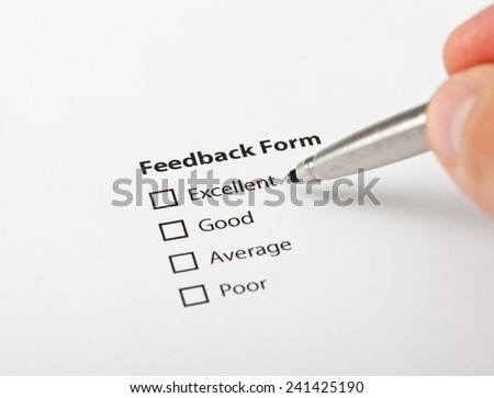 Decision moment. Man is about to fill the feedback form.  Quality control concept. - stock photo