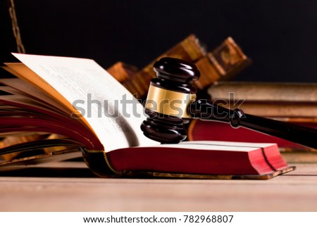 decision of a court regarding the rights and liabilities of parties. Judge`s gavel on law book