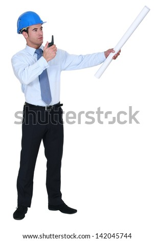 Decisive architect giving orders - stock photo
