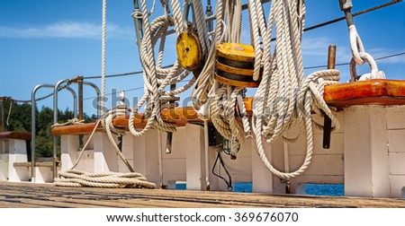 Deck and ropes, rigging on a wooden sailboat. Close up view - stock photo