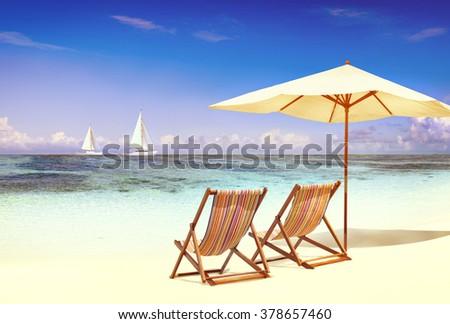 Deck Chair on the Tropical Beach Ocean Concept - stock photo