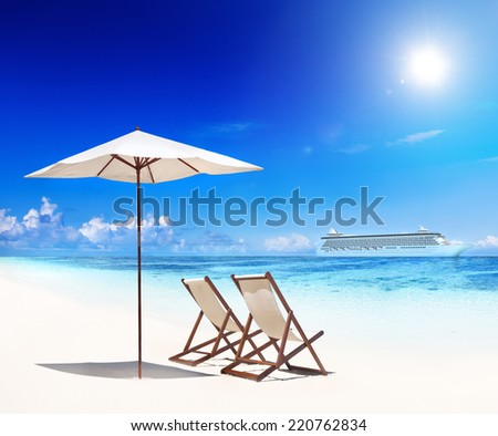 Deck chairs on a beach - stock photo