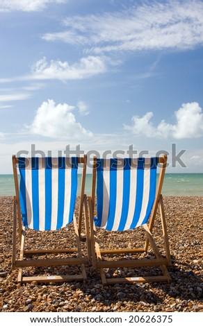 Deck Chairs on Beach - stock photo