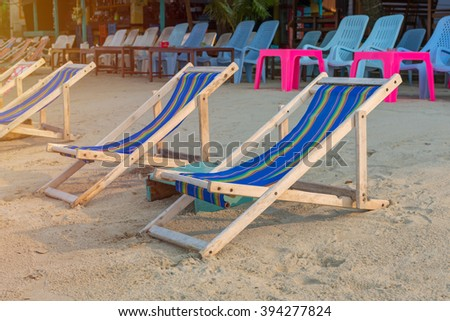 Deck chairs on the tropical beach. - stock photo