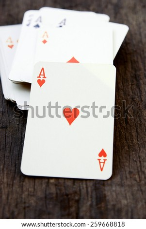 Deck of cards on wooden background (ace of heart) - stock photo
