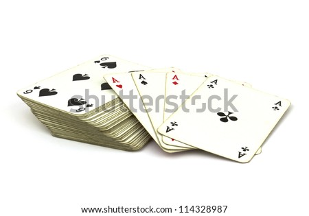 Deck of old playing cards with ace cards on top isolated on white background.