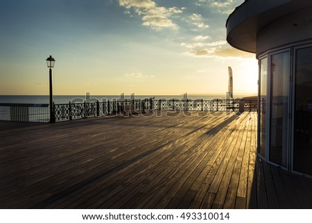 Deck of the new Hasting pier in late afternoon sunshine