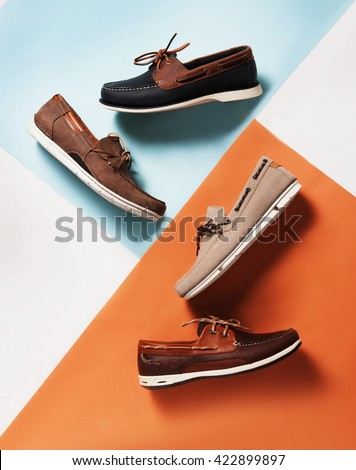 deck summer shoes in pan with a colorful  symmetric background with pastel colors