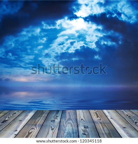 Deck view of a ocean or lake during twilight - stock photo