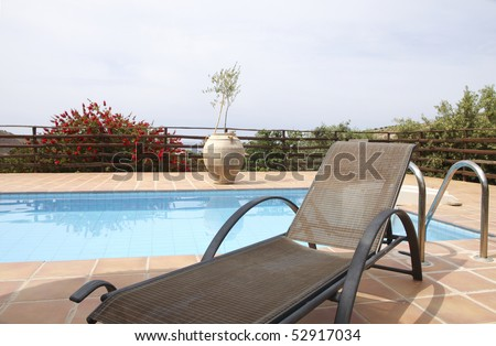 Deckchair near swimming pool