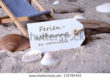 Deckchair, sand and label with lettering apartments for rent/beach/holiday