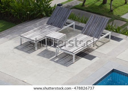 Deckchairs and swimming pool.