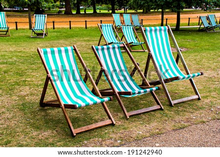 Deckchairs in St James park, London - stock photo