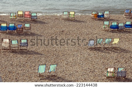 Deckchairs on beach at Beer in South Devon - stock photo