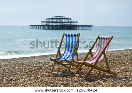Deckchairs on beach in Brighton - stock photo