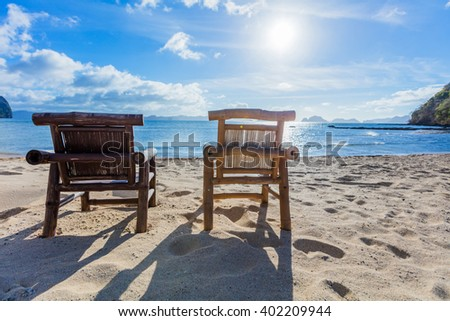 Deckchairs on the beach - stock photo