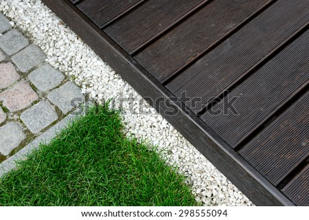 decking and lawn in a place of rest in the courtyard of a private house - stock photo
