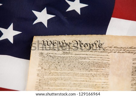 Declaration of Independence against an American flag. - stock photo