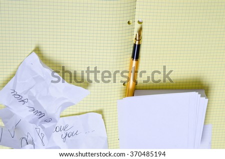 declaration of love. confessions of love. white note paper and golden pen, school notebook with pen,  crumpled sheets with entries - stock photo