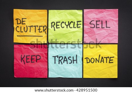 declutter concept (keep, recycle, trash, sell, donate - handwriting on color sticky notes against black paper background - stock photo