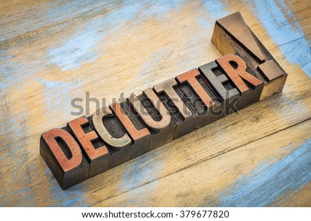 declutter exclamation - word in vintage letterpress wood type printing blocks stained by color inks - stock photo