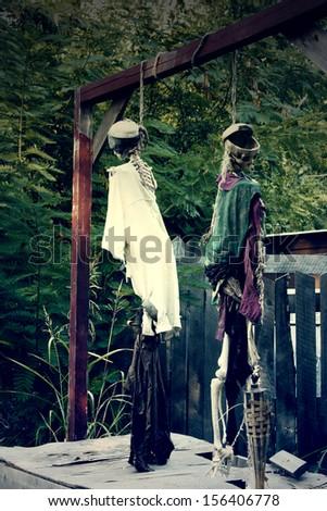 Decomposed skeleton in dark Halloween colors - stock photo