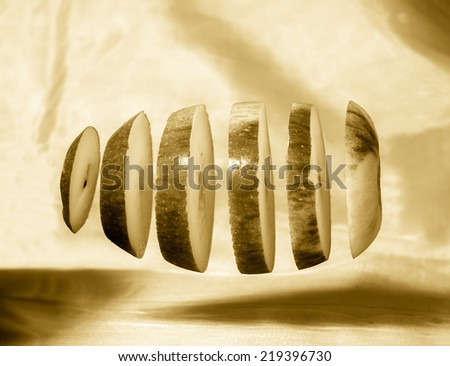 Deconstructed Floating Apple on Plain Background - Abstract Cool Still Life in Sepia - stock photo