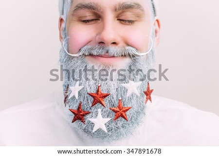 Decorated beard. Santa Clause horizontal. Happy New Year. Marry Christmas.  - stock photo