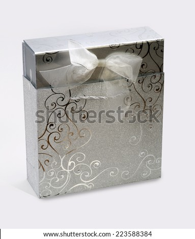 Decorated box and wrapping paper with silver ornaments - stock photo