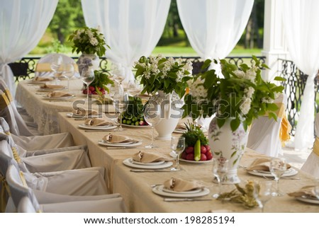 Decorated chair and tables set for wedding  - stock photo