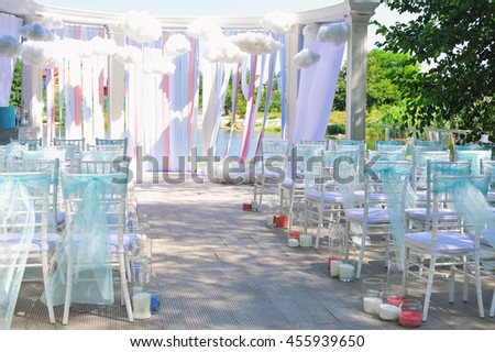 Decorated chairs from outdoors wedding ceremony, rear view