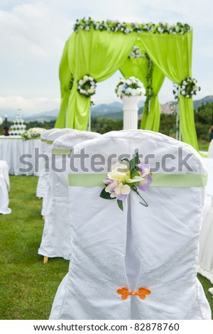 decorated chairs on a outdoor wedding - stock photo