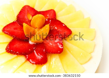 Decorated cheese cake with fresh fruits and berries on the top, isolated on white plate