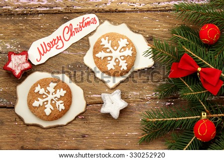 Decorated Christmas cookies and fir tree  - stock photo