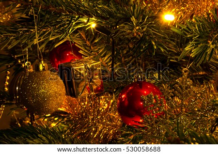 Decorated Christmas fir tree with decorations and colorful lights on blurred, sparkling and fairy background