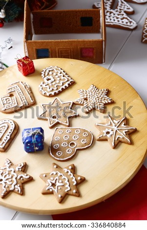 Decorated christmas gingerbread cookies on a wooden table - stock photo