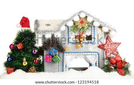 Decorated Christmas house isolated on white - stock photo