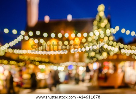 Decorated Christmas market. Abstract blurred lights background
