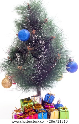 decorated Christmas tree and gifts on a white background selective focus - stock photo