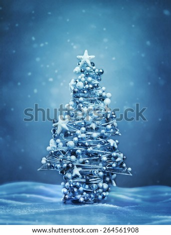Decorated christmas tree at winter evening - stock photo