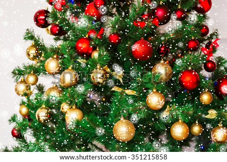 Decorated Christmas tree. Beautiful Christmas living room with Christmas tree, stars and snow - stock photo