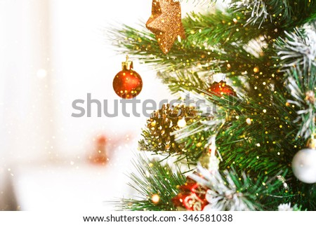 Decorated Christmas tree. Beautiful living room with  glitter lights - stock photo