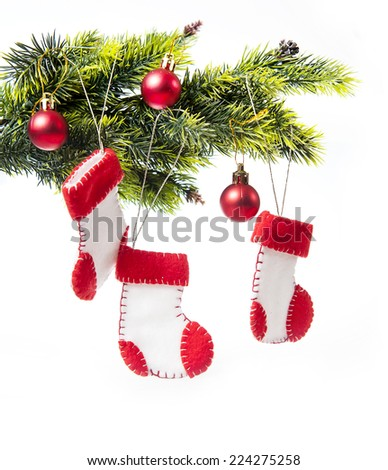 decorated Christmas tree decorated with Christmas boots Santa Claus on a white background. - stock photo